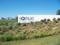 Northlake Business Center sign with Texas Motor Speedway in background